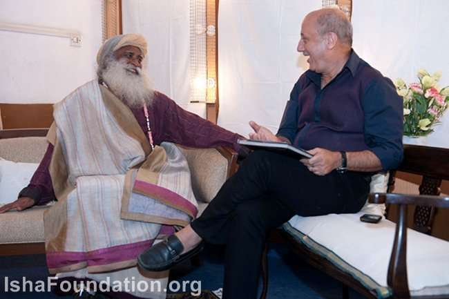 Sadhguru sharings a light moment with host Anupam Kher before the event