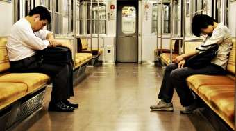 Commuters sleeping in the subway - Improving Sleep Quality