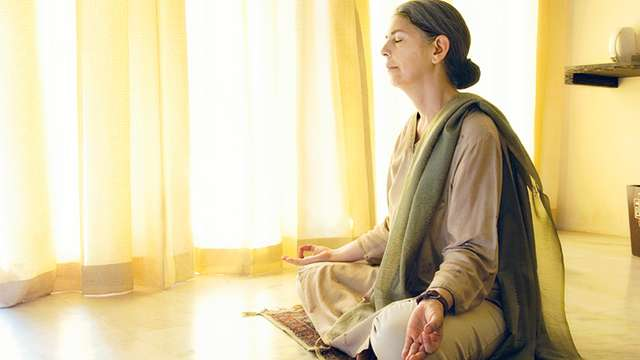 Retired Woman Meditating - What to do when you retire - Life after retirement