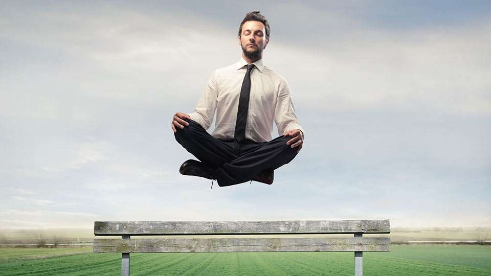 meditation office. office guy floating in meditation no need to balance spirituality and materialism k