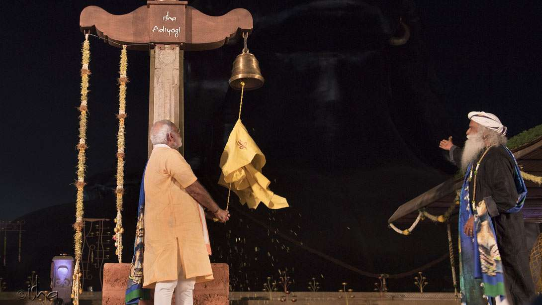 PM Narendra Modi symbolically ringing in the golden age of Adiyogi and the yogic sciences he first transmitted