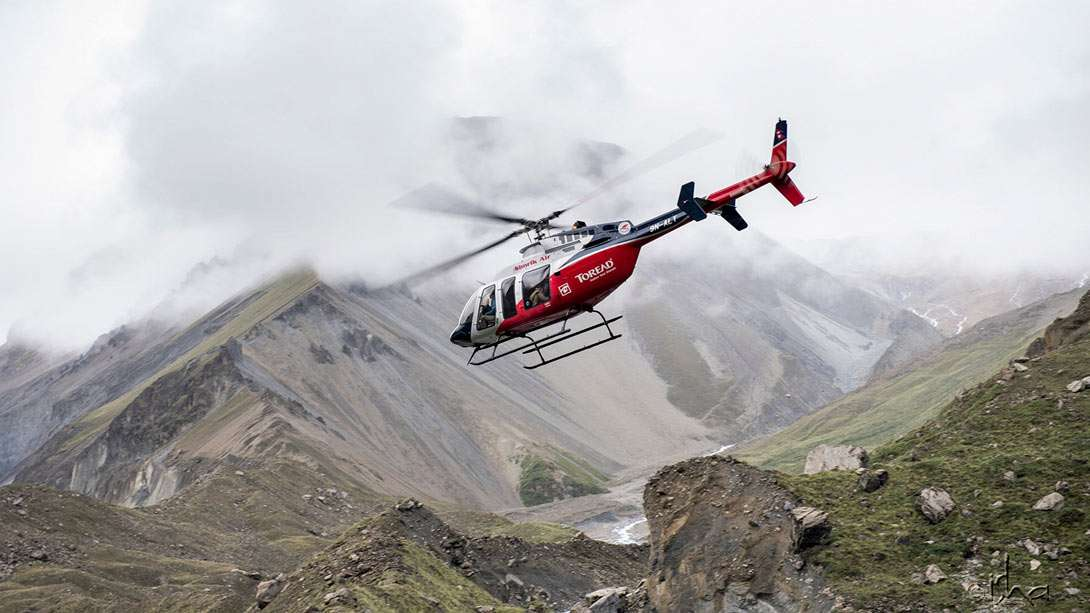 Finally, the clouds lift enough for the helicopter to take off from Tilicho base camp